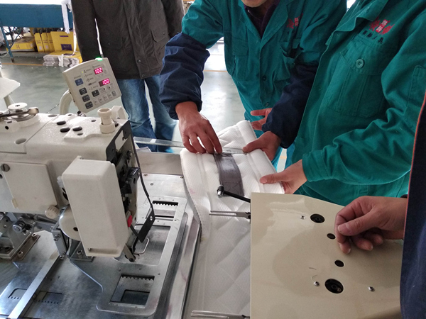 自动床垫拉手带缝合机